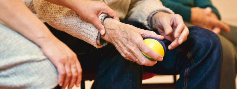 man with arthritis holding ball